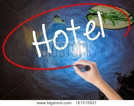 Woman Hand Writing Hotel With Marker Over Transparent Board