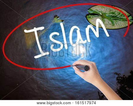 Woman Hand Writing Islam With Marker Over Transparent Board