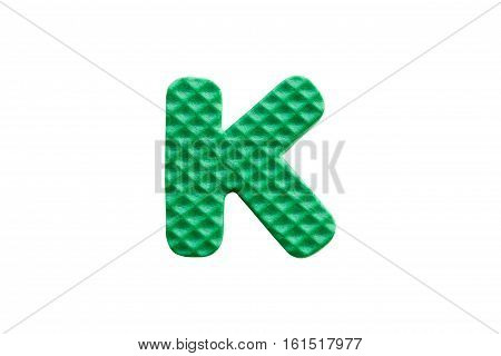 Green Alphabet K Made From Eva Foam On White Background