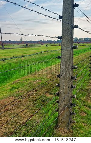 Oswiecim, Poland - May 2, 2014: Barbed wire at concentration camp Auschwitz Birkenau Poland.