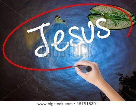 Woman Hand Writing Jesus  With Marker Over Transparent Board