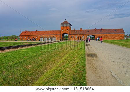 Oswiecim, Poland - May 2, 2014: Main entrance gate into concentration camp in Auschwitz Birkenau Poland.