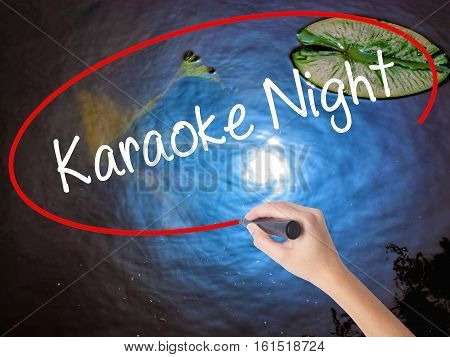 Woman Hand Writing Karaoke Night With Marker Over Transparent Board