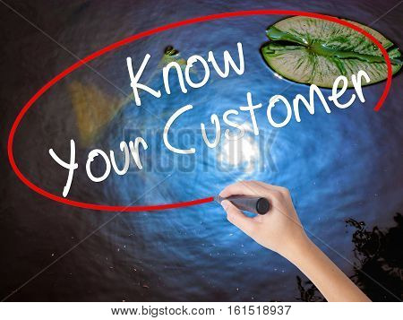 Woman Hand Writing Know Your Customer With Marker Over Transparent Board