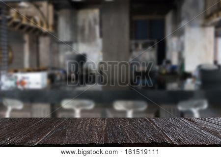 Counter Bar In Restaurant Interior Blur Background With Selected Focus Empty Wood Table For Display