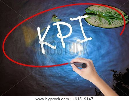 Woman Hand Writing Kpi (key Performance Indicator) With Marker Over Transparent Board