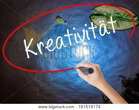 Woman Hand Writing Kreativität (creativity In German)   With Marker Over Transparent Board