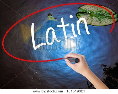 Woman Hand Writing Latin With Marker Over Transparent Board.