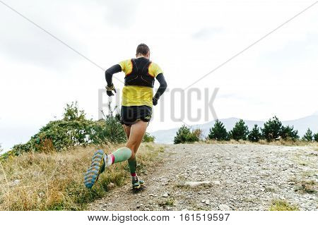 male athlete runner running mountain marathon skyrunning
