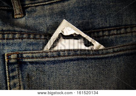 Condom in the pocket of a jeans