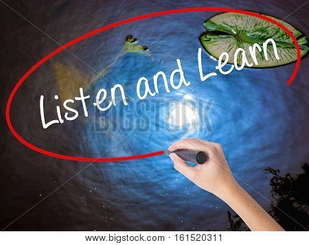 Woman Hand Writing Listen And Learn With Marker Over Transparent Board