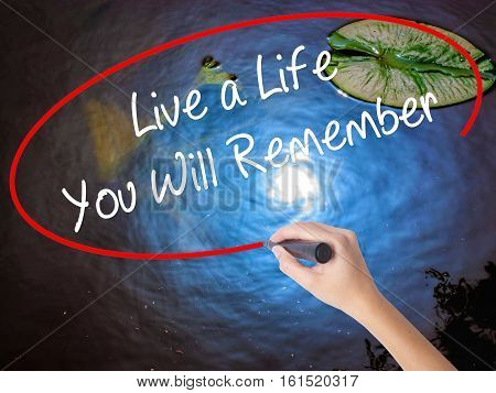 Woman Hand Writing Live A Life You Will Remember With Marker Over Transparent Board