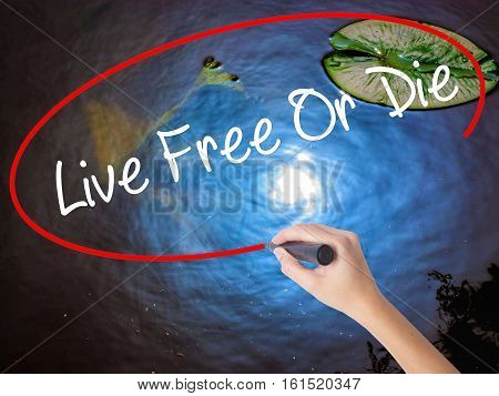 Woman Hand Writing Live Free Or Die With Marker Over Transparent Board.
