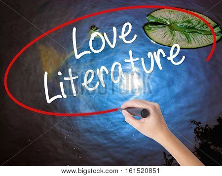 Woman Hand Writing Love Literature With Marker Over Transparent Board.