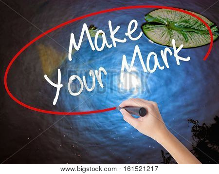 Woman Hand Writing Make Your Mark With Marker Over Transparent Board