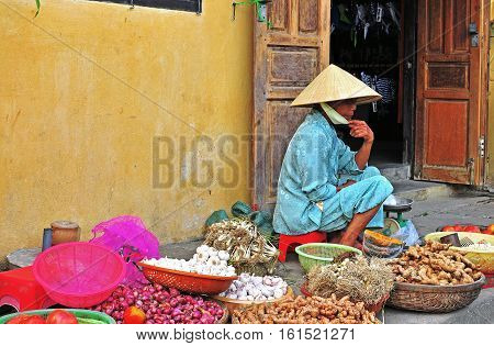 HOI AN VIETNAM - MARCH 12: Woman on the food market in Hoi An Vietnam on March 12 2015. Hoi An is a city in central Vietnam on the coast of the East Sea.