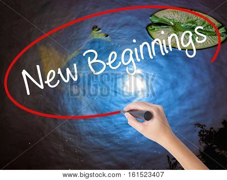 Woman Hand Writing New Beginnings With Marker Over Transparent Board