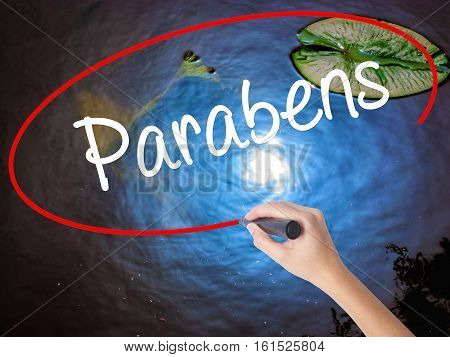 Woman Hand Writing Parabens (happy Birthday In Portuguese) With Marker Over Transparent Board