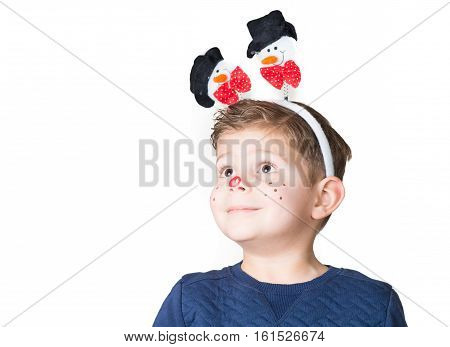 lovely and adorable boy kid child with Christmas paint on his face and snowman on his head