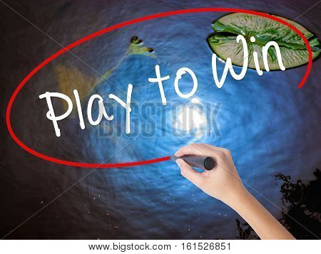 Woman Hand Writing Play To Win With Marker Over Transparent Board