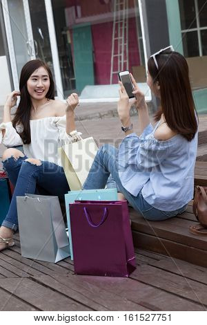 Happy Asian Woman With Colorful Shopping Bags Take Photo At Department Store Shopping Mall