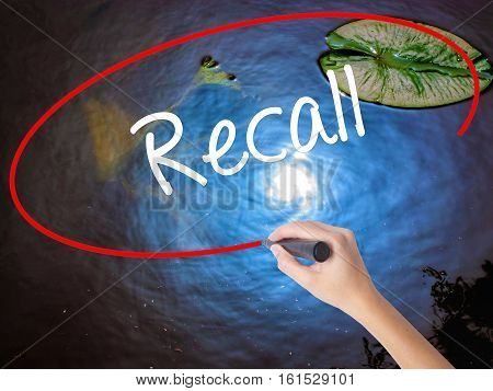 Woman Hand Writing Recall  With Marker Over Transparent Board