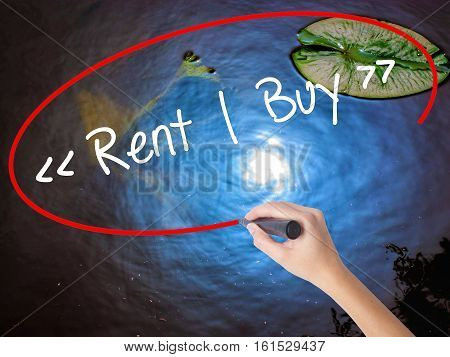 Woman Hand Writing Rent - Buy  With Marker Over Transparent Board.