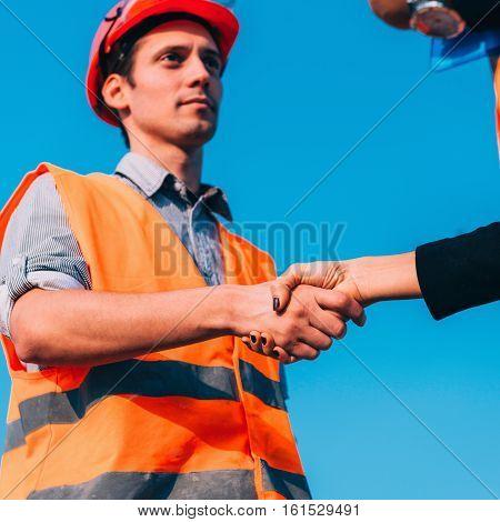 Civil Engineers Handshaking