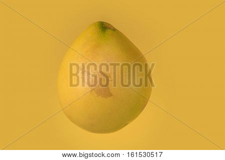 Fresh pomelo isolated on yellow background