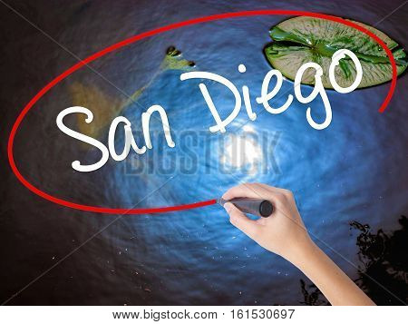 Woman Hand Writing San Diego With Marker Over Transparent Board