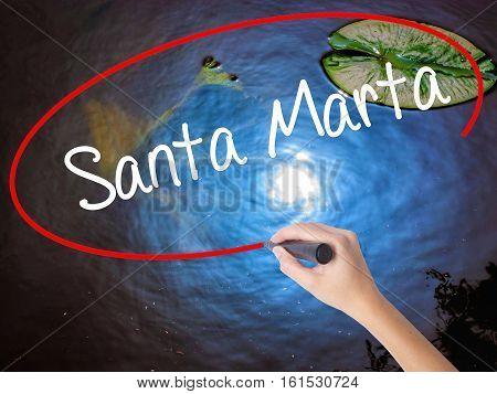 Woman Hand Writing Santa Marta With Marker Over Transparent Board