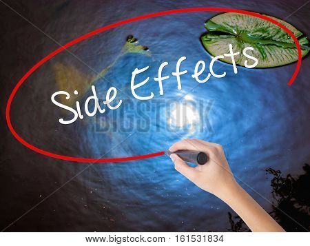 Woman Hand Writing Side Effects With Marker Over Transparent Board