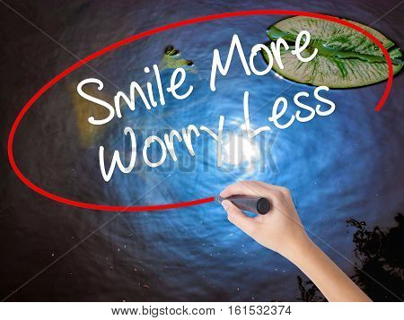 Woman Hand Writing Smile More Worry Less With Marker Over Transparent Board