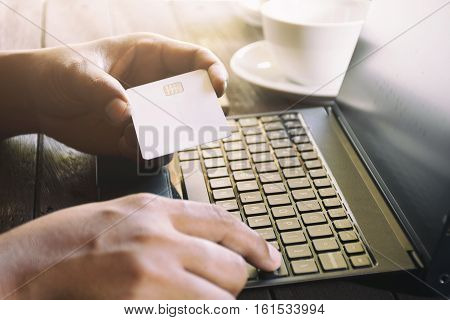 Man Using His Computer Laptop Holding Credit Card  To Shopping Online Concept, Digital Business Or E