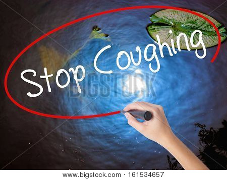Woman Hand Writing Stop Coughing With Marker Over Transparent Board