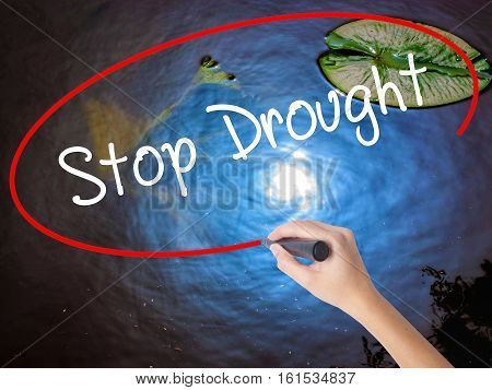 Woman Hand Writing  Stop Drought With Marker Over Transparent Board