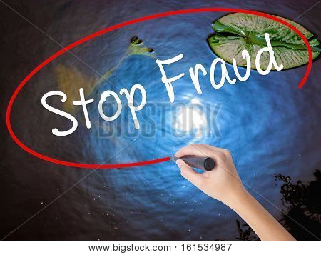Woman Hand Writing  Stop Fraud  With Marker Over Transparent Board