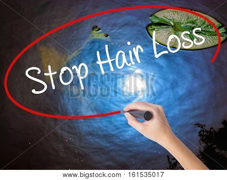Woman Hand Writing Stop Hair Loss  With Marker Over Transparent Board