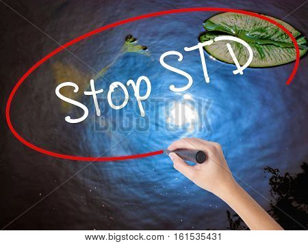 Woman Hand Writing Stop Std (sexually Transmitted Diseases) With Marker Over Transparent Board