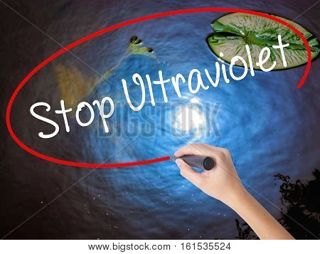 Woman Hand Writing Stop Ultraviolet With Marker Over Transparent Board