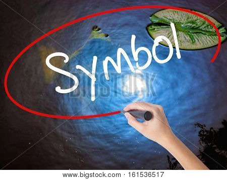 Woman Hand Writing Symbol With Marker Over Transparent Board