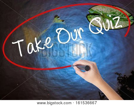Woman Hand Writing Take Our Quiz With Marker Over Transparent Board