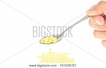 A tablespoon of drugs isolated on white background