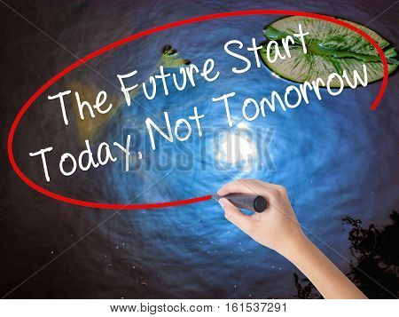 Woman Hand Writing The Future Start Today, Not Tomorrow With Marker Over Transparent Board.