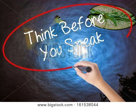 Woman Hand Writing Think Before You Speak With Marker Over Transparent Board