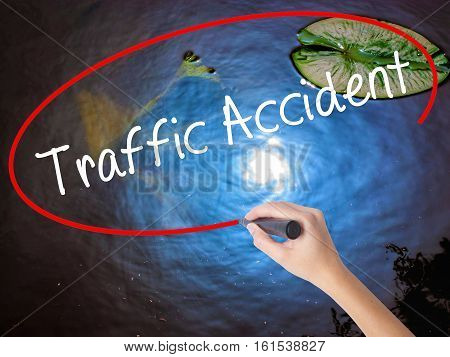 Woman Hand Writing Traffic Accident With Marker Over Transparent Board