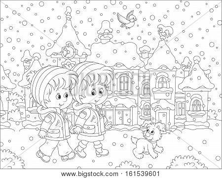 Small children walking through a winter town