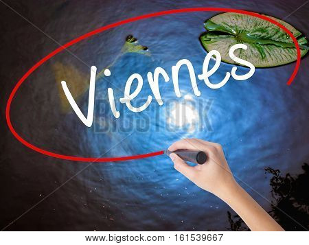 Woman Hand Writing Viernes (friday In Spanish) With Marker Over Transparent Board
