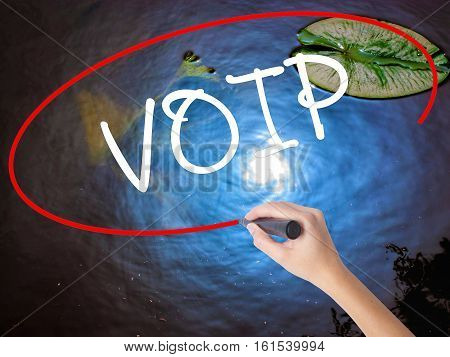 Woman Hand Writing Voip With Marker Over Transparent Board