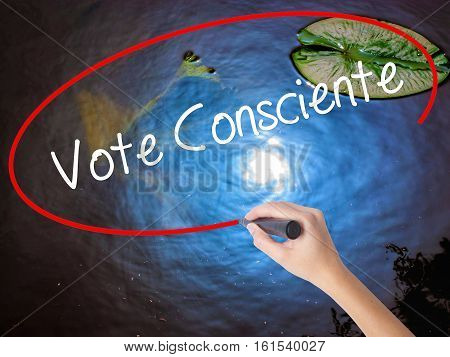 Woman Hand Writing Vote Consciente   (vote Conscientiously In Portuguese) With Marker Over Transpare